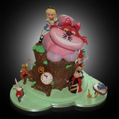 A 3D sculptured cake for an 'Alice in Wonderland' themed wedding.  The figures are all handcrafted from sugar