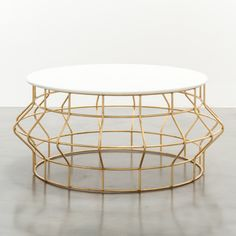 "HALSTON COFFEE TABLE HALSTON COFFEE TABLE 42"" DIAMETER @ WIDEST POINT (36″ DIAMETER MARBLE TOP) X 19"" HIGH shine by sho AVAILABLE IN GOLD LEAF AND SILVER LEAF OVER IRON WITH WHITE MARBLE TOP"