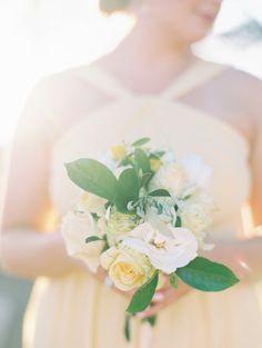 Yellow and ivory rose wedding bouquet: http://www.stylemepretty.com/destination-weddings/hawaii-weddings/2016/11/22/yellow-olive-maui-wedding-by-the-sea/ Photography: Wendy Laurel - http://www.wendylaurel.com/ and Jeffery Oltman - http://www.imagesbyjeffrey.com/