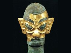 Image of Bronze sculpture of Sanxingdui Hoard in South West China. Note the unusual Tiki-Polynesian character of the sculpture and the slanted eyes, perhaps symbolizing the slit like eyes of the snake. These masks may represent the faces of the maritime Naga snake shamans that traveled the oceans of the Pacific long ago, eventually settling in the valleys of Southwest China near the 12th century B.C.