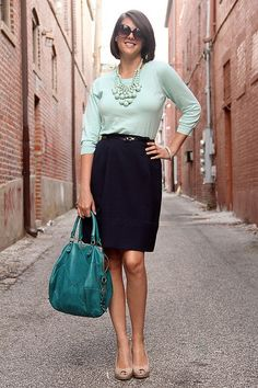 Mint sweater, mint statement necklace, black skirt, and heels