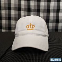 Feeling Noble?  To be the King or Queen of your castle, you'll need a regal crown to place upon your head.  You're in luck, we have this white embroidered royal crown hat that will let your kingdom know you are part of the Royal Family!  #Crown #Royal #RoyalFamily #Royalty #Regal #Noble #Nobility #Embroidered #White #Hat #Cap #Gifts