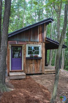 Woodsy tiny house with a window box and pretty purple door. #tinyhouse / The Green Life <3
