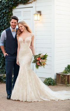 This beaded wedding gown featuring lace and silk chiffon over satin from Martina Liana is a visual masterpiece with its flirty low-cut V-neckline and illusion-tulle keyhole back. Beautiful buttons cover an easy-to-close zipper. The skirt falls freely into a scalloped lace train.