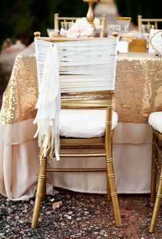 Brides.com: . This gilded set-up takes neutral to glam. A sequin tablecloth, sparkling ribbon, and gold chair, designed by Middle Aisle Weddings, are fierce and feminine.