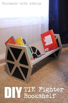 How to build a Star Wars TIE Fighter bookshelf | from Ashley Grenon --- Awesome geeky kids room decor! Simple Star Wars shelf for kids using plywood and paint.