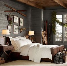 winter lodge cabin lakehouse bedroom rustic cozy skis snowshoes, naturals neutral grey wood white, black and white outdoor framed photos