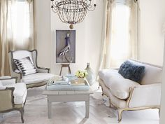 A fantastic Paris flea market sofa in a warm, bright #livingroom. #white #parisian