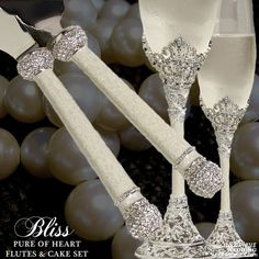 The Bliss Pure of Heart Cake Knife and Server Set from Luxurious Wedding Accessories has a vintage romantic flair. Hand-set clear pave Swarovski Cr...