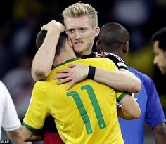 Finisher: Andre Schurle, who scored Germany's final two, consoles his Chelsea team-mate Oscar. July 8/14