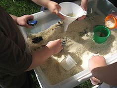 Forget the messy sand. Rice table. Perfect place to bury cars and play with spare measuring cups.