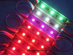 "These individually addressable (digital; ""smart"") LED module strings (WS2801?) are starting to appear in store windows, replacing neon perimeter tubes. Analog (non addressable, ""dumb""; whole string one color at a time) and single LED module strips have also become widespread)."