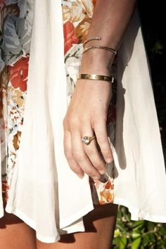 Miley Cyrus engagement ring...  Looooove the bracelets  AND THE CARTIER LOVE BRACELET
