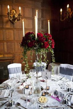 Silver Candelabra with Red Roses by Exclusively Weddings. Photo by Kate Jackson