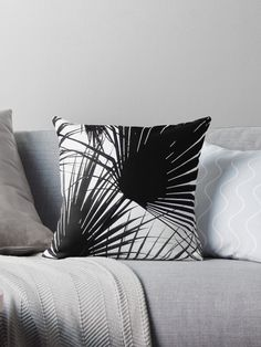 Buy Black and White Tropical Leaves on Throw Pillow by Dominique Vari on redbubble.com/people/dominiquevari A modern, minimal and stylish Japanese inspired design that reflects the beauty of Nature with a series of palm leaves, forming an abstract 'tropical' screen. A perfect choice on Pillow to energise your any sofa, bed or chair. Tropical and botanical pillows for Nature lovers