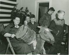 "Residents of the Outer Banks have long celebrated two Christmases: a traditional version with Santa Claus on December 25, and Old Christmas, which takes place on January 6 and features a particularly virile bull named ""Old Buck"" (photo courtesy of North Carolina County Photographic Collection #P0001, North Carolina Collection Photographic Archives)"