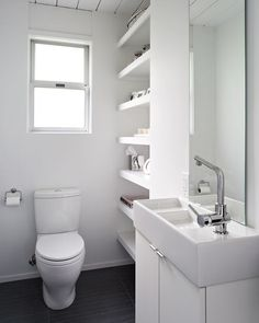 Contemporary Powder Room with American standard white studio round front two-piece dual flush toilet, Built-in shelving