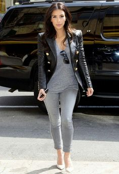 Say what you will about Mrs. Kardashian-West but I love most of her styles! Grey t-shirt & ankle length skinny jeans dressed up with cream high heels and a military style leather jacket!  pinterest: @qqueennvee