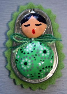 Matrioskas made with soda can tabs, modeling clay, and paint!