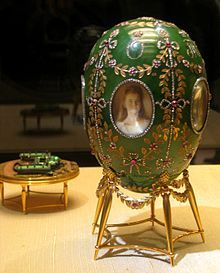 The Alexander Palace Egg is a jewelled Easter egg made under the supervision of the Russian jeweler Peter Carl Fabergé in 1908, for the then Tsar of Russia, Nicholas II. Nicholas presented it as an Easter gift to his wife, Alexandra Fyodorovna. It is held in the Kremlin Armoury Museum in Moscow.