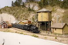 360 heads a westbound stock extra Hobby Trains, Diorama, Thing 1, Water Tower, Rio Grande, Model Trains, Paint Colors, Cabin, House Styles