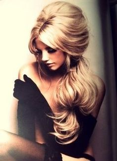 Love big hair. Style is so reminiscent of Bardot & her classic bouffant.