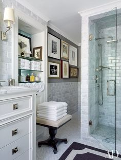The master bath in a Kansas City, Missouri, apartment contains shower fittings and towels by RH | archdigest.com