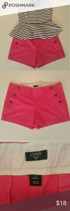 J. Crew bright pink button front cotton shorts Cute J. Crew bright pink button front cotton shorts with a little bit of stretch. Perfect for a summer day out and such a fun color. Side zipper closure. Shorts are in good used condition. Measurements as pictured. Please contact me with any questions. J. Crew Shorts