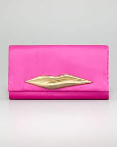 I have always considered clutches as a must for formal occasions, not something I would ever buy on a whim. Behold the design that changed my style mind: Carolina Lips Clutch (in black or fuchsia) by Diane von Furstenberg. Via Neiman Marcus