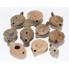 Ten Roman and Byzantine clay oil lamps;