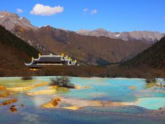 Huanglong, northwest Sichuan, China, known for some colorful pools formed by calcite deposits.