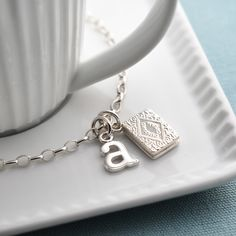 Silver Custard Cream Charm Bracelet - Lily Charmed