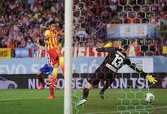 Neymar of Barcelona beats Thibaut Courtois of Atletico Madrid to score  his team's opening goal during the Spanish Super Cup first leg match between Atletico de Madrid and Barcelona at Vicente Calderon Stadium on August 21, 2013 in Madrid, Spain.