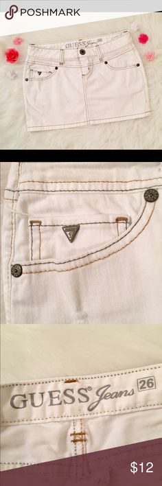 Guess Jeans women's size 26 white denim skirt Size 26 Guess Jeans white denim mini skirt! Will be perfect for spring and summer! Has brown stitching and a rhinestone G on back pocket. 96% cotton / 4% spandex so material has a little stretch to it. Has a very small stain on back ( see photos )  🌸Waist - 14 in.🌸  🌸Length - 12 in.🌸   🌸🌼WELCOME TO MY SHOP🌼🌸  All items are from a smoke free & clean home! 1 day handling time for all items, but I do try and ship same day if possible. If you…