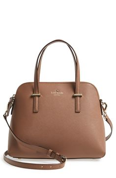 Love the elegant arcing silhouette of this pretty Kate Spade satchel.