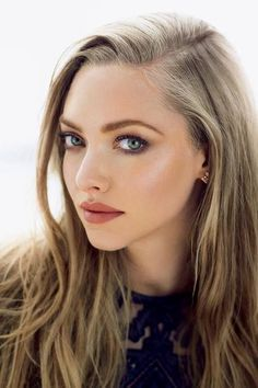 Amanda Seyfried is radiant with this earthy mauve toned look!