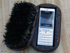 Contraband prison cell phone hidden in a brush.   Here are some ideas on how to sneak cell phones back onto The Island