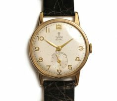 1950s vintage mens Rolex Tudor Royal 9ct Gold Gents Wristwatch. Leather strap with silver dial & raised gilt Arabic numerals