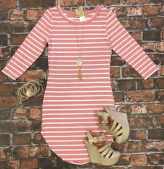 The On the Horizon Tunic Dress in Dusty Rose is striped, fitted, and oh so fabulous! A great basic that can be dressed up or down! Sizing: Small: 0-3 Medium: 5-7 Large: 9-11 True to Size with a Stretc