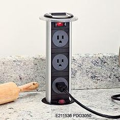 hidden pop-up outlet - this is awesome, especially in a kitchen!