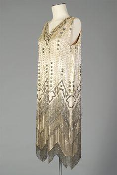 Cream silk satin dress with pearls and beaded fringe, American, 1920s, KSUM 1983.1.2488.