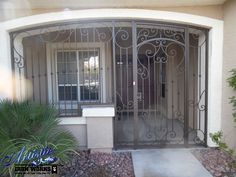 Wrought Iron Entry Enclosure - Not the best looking ideaa, but as a retrofit, not bad. Front Entry Decor, Front Door Entryway, Grand Entryway, Entrance Gates, Entryway Decor, Wrought Iron Security Doors, Wrought Iron Doors, Wrought Iron Fences, Security Gates