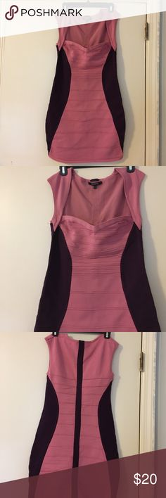 Bandage dress Size large, pink and purple dress that hugs and compliments your curves. And holds everything in place beautifully!!! Length is good. Not too short and not too long. Like new. Wore once Dresses Midi