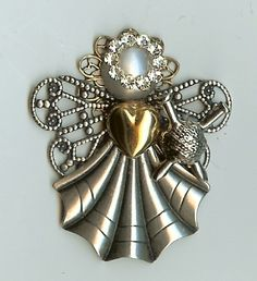 Very nice and pretty Angel pin.