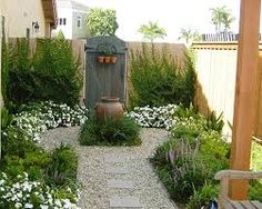 Front Yard Garden Design This is also another look I'd like for the side garden moving between the patio and the back grassy area - Pea gravel patio pictures Small Front Yard Landscaping, Backyard Landscaping, Landscaping Ideas, Backyard Ideas, Small Patio, Natural Landscaping, Backyard Designs, Patio Ideas, Modern Backyard