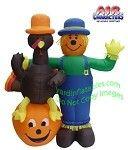 Scarecrow Standing Next To Turkey On Pumpkin