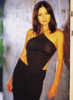 Prue Halliwell always had some great 90's fashion. The quintessential backless 90's triangle halter.
