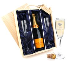 """Raise a toast for the married couple with this gorgeous wedding gift with two champagne flutes and a bottle of Veuve Cliquot Champagne. beautifully presented in a wooden case with matching wooden """"congratulations"""" tag. 5 Year Anniversary Gift, 5th Wedding Anniversary, Veuve Cliquot, Wedding Flutes, Wooden Case, Champagne Flutes, Meaningful Gifts, Wedding Gifts, Congratulations"""