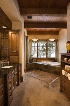 luxury rustic bathroom design. love the openess about this and that tub yes please!