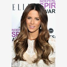 Bronzed Brunette - Whether you're lightening up a head full of dark brown hair or taking blonde locks a shade darker, a chestnut brown mane -- like the one seen here on actress Kate Beckinsale at the 2011 Film Independent Spirit Awards -- will bring some warmth and depth to your summer 'do. Keep it looking season appropriate by adding highlights in shades of gold, auburn and copper to give the color a little shine.  Read more: Summer Hair Color Inspiration From Celebs | eHow